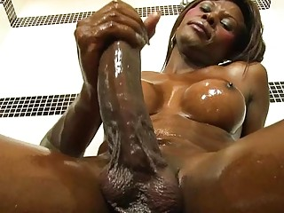Dreamy ebony shemale performs one of the sexiest handjobs ever