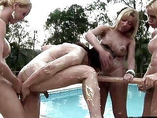 Dirty chicks with dicks have anal foursome by the pool