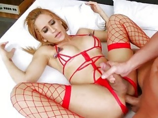 Charming blonde shemale in red fishnets gets her asshole raped