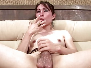 Tranny strips off her clothes and beats her meat