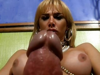 Blonde busty shemale teases by beating her raging boner