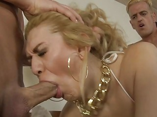 Seductive shemale gets pleasured by three raging boners