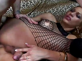 Brunette shemale gets her cock sucked by a gorgeous man