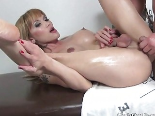 Naughy redhead shemale spreads her butt cheeks to fuck hard