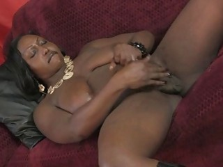 Mature ebony BBW shemale jerks off her big black cock