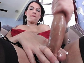 Appealing brunette with huge tits wanks her cock to an orgasm